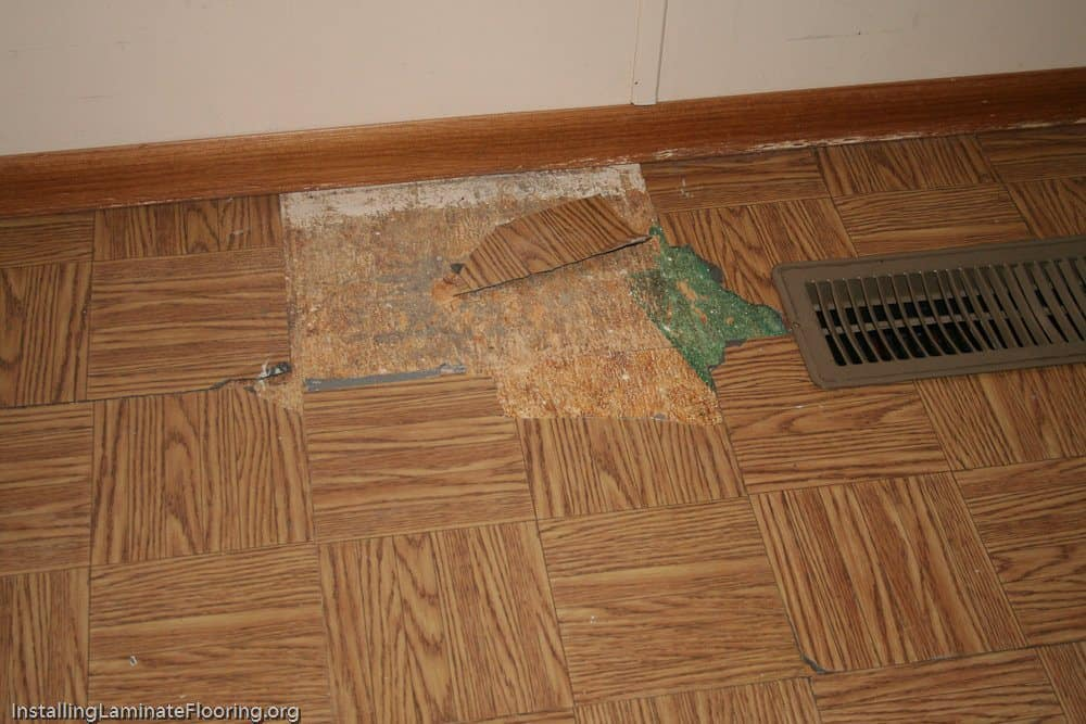 Example of worn out self stick floor tiles