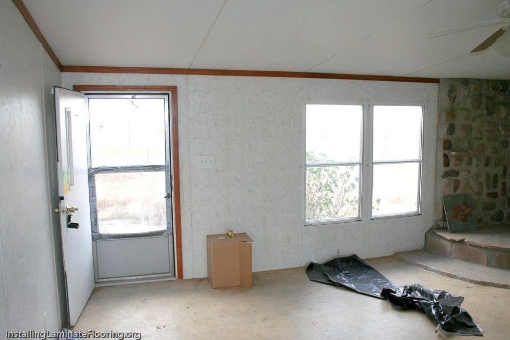 Mobile home living room badly in need of renovation