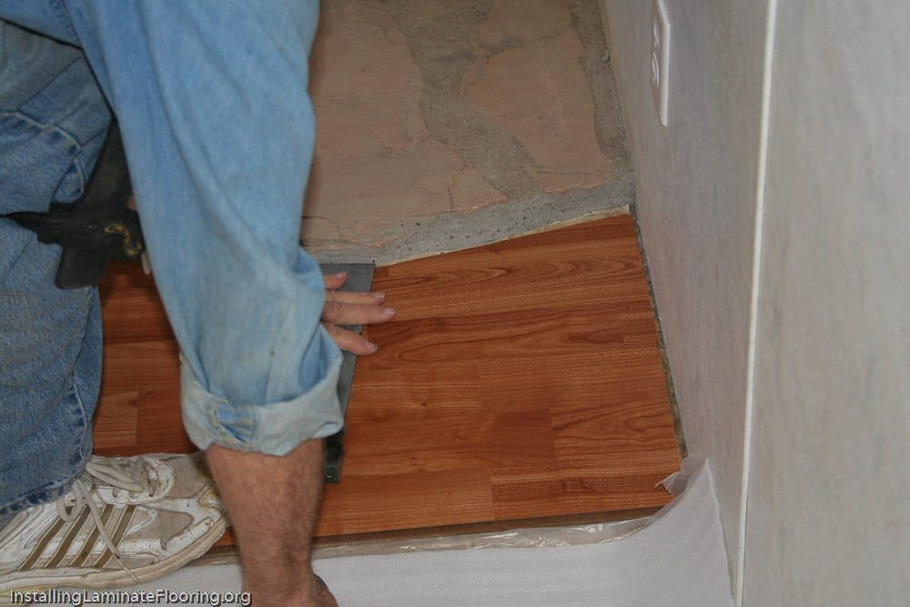 Installing laminate against the fireplace